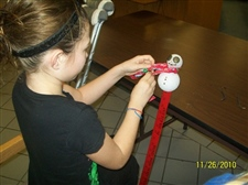 Making snowman snow gauges during Christmas Traditions -- November 2010